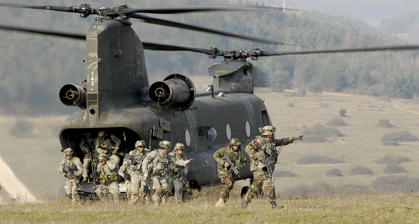 U.S. Army Soldiers from 173rd Airborne Brigade Combat Team dismount a CH-47 Chinook helicopter during training at the Joint Multi-National Training Center in Hohenfels, Germany, March 31, 2007, for their upcoming deployment to Afghanistan. The Soldiers refined their skills in mounted and dismounted patrols, small unit tactics, military operations in urban terrain, counter-improved explosive devices and long range marksmanship.  (U.S. Army photo by Gary L. Kieffer) (Released)
